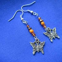 EARRINGS: Butterfly with orange glass beads